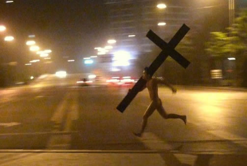 Naked Man Carrying Giant Cross Runs Through Beijing China