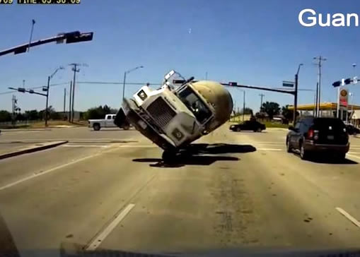 Cement Truck Runs A Red Light And Tips Over