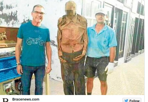 Gravedigger Posts Photo With Exhumed Body – Gets Suspended